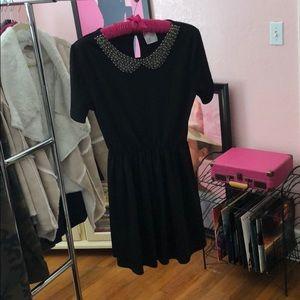 Black mini dress with beaded collar